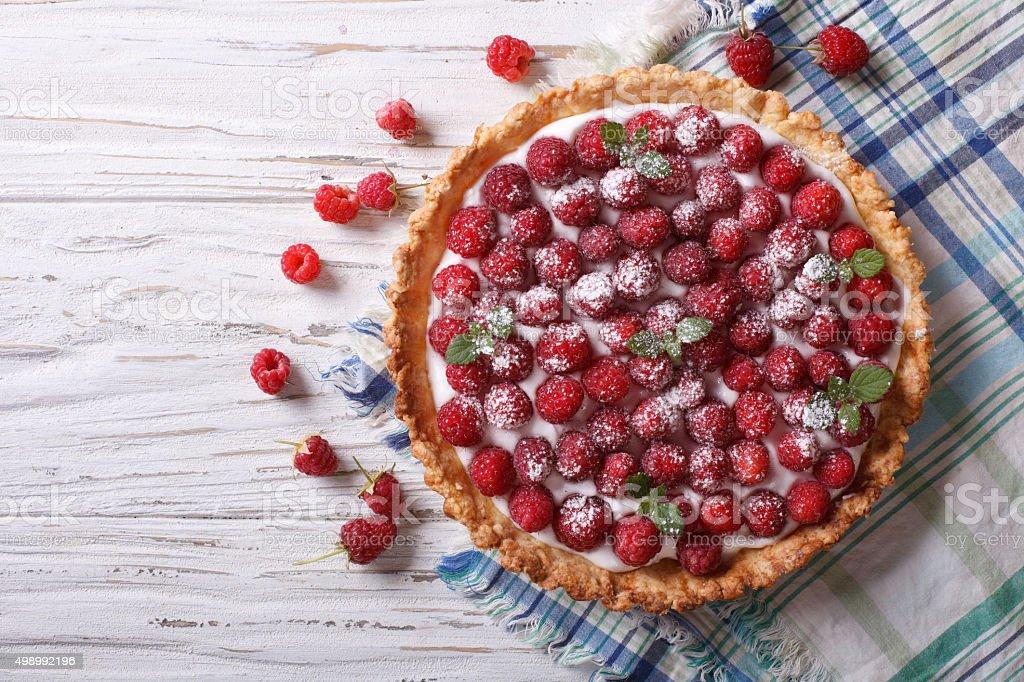 Fresh raspberry tart with cream cheese. horizontal top view stock photo