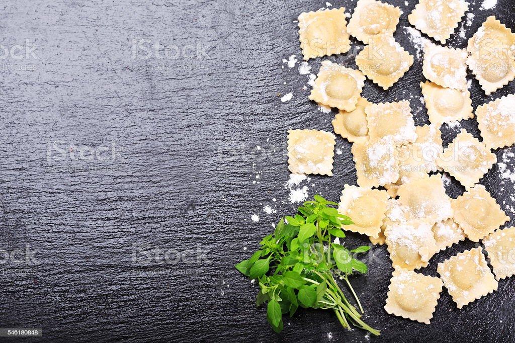 fresh ravioli with green basil stock photo