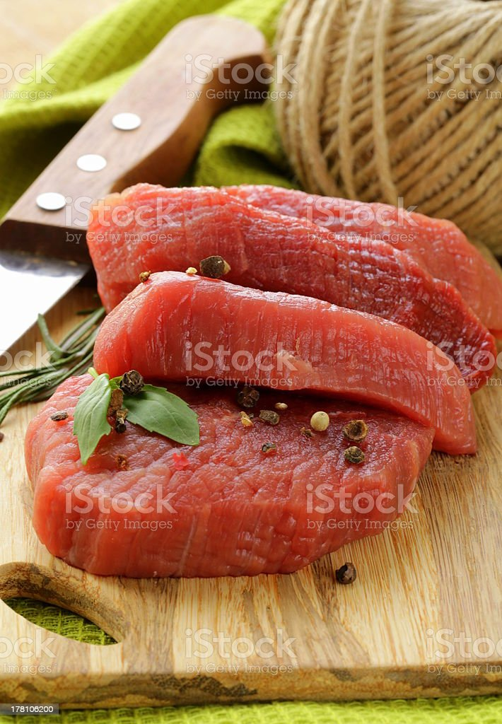 fresh raw beef meat on cutting board royalty-free stock photo