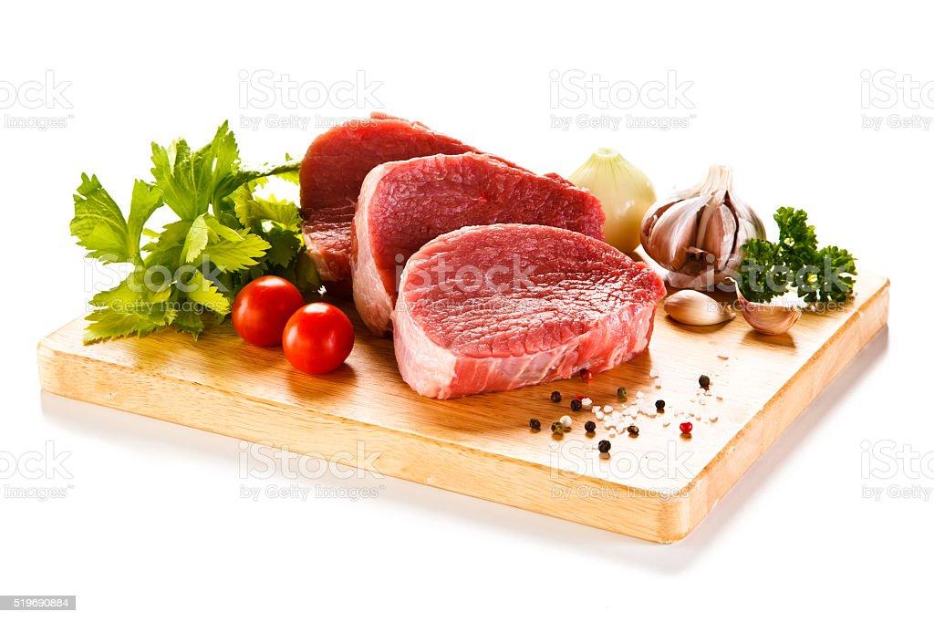 Fresh raw beef on cutting board stock photo
