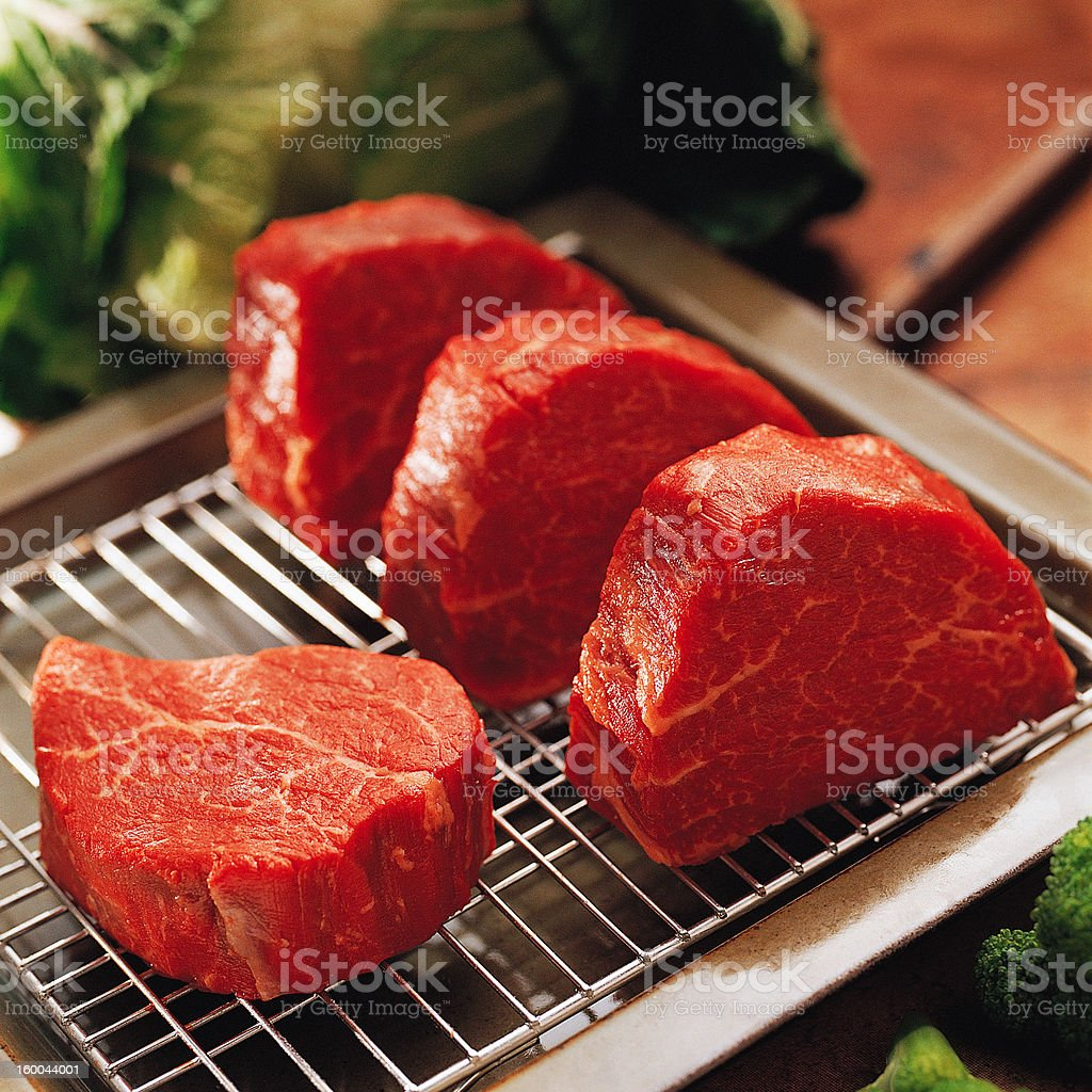 Fresh raw beef on kitchen table royalty-free stock photo