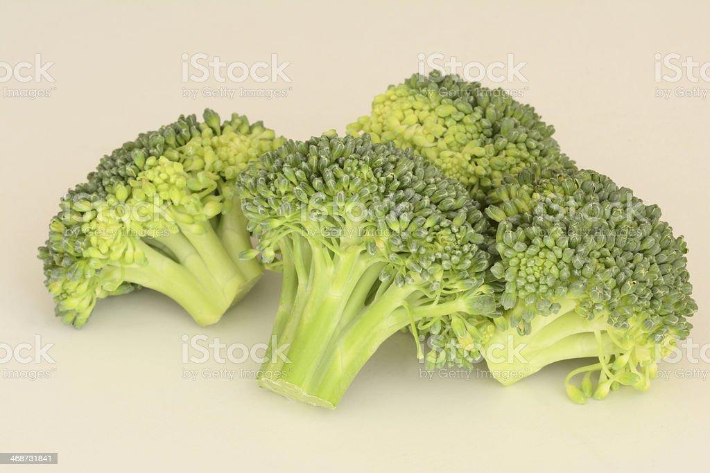 Fresh raw Broccoli on creamy background royalty-free stock photo