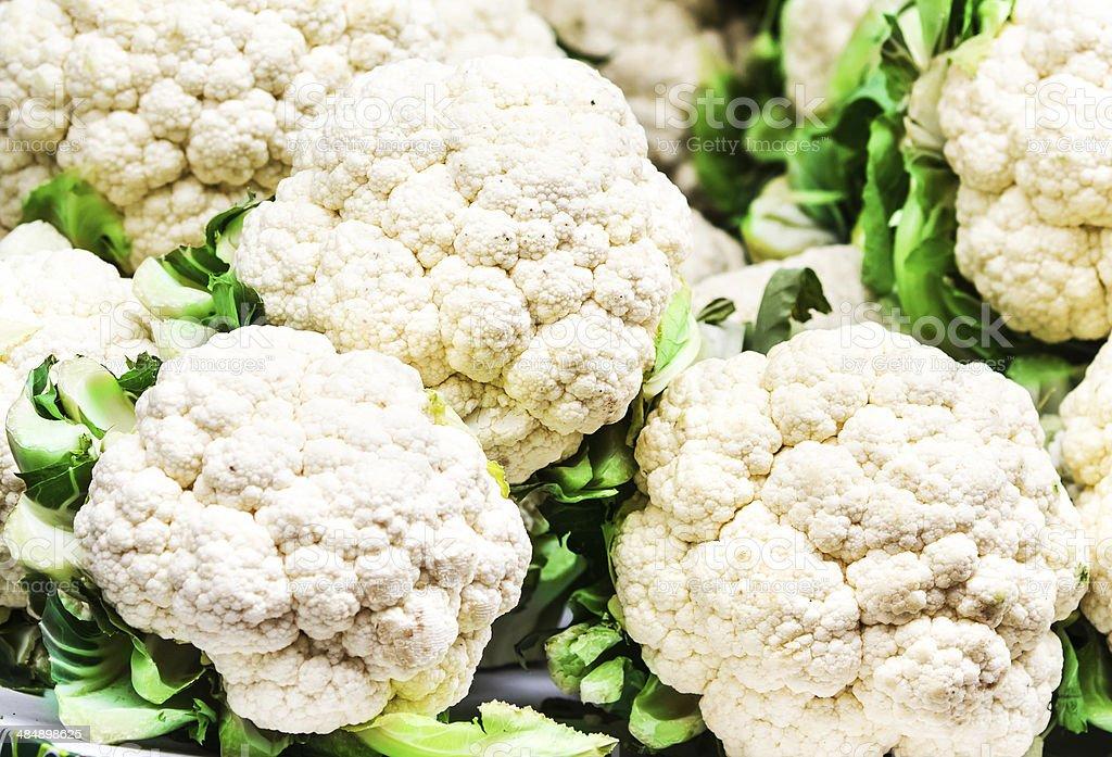 Fresh raw cauliflower on market close up. stock photo
