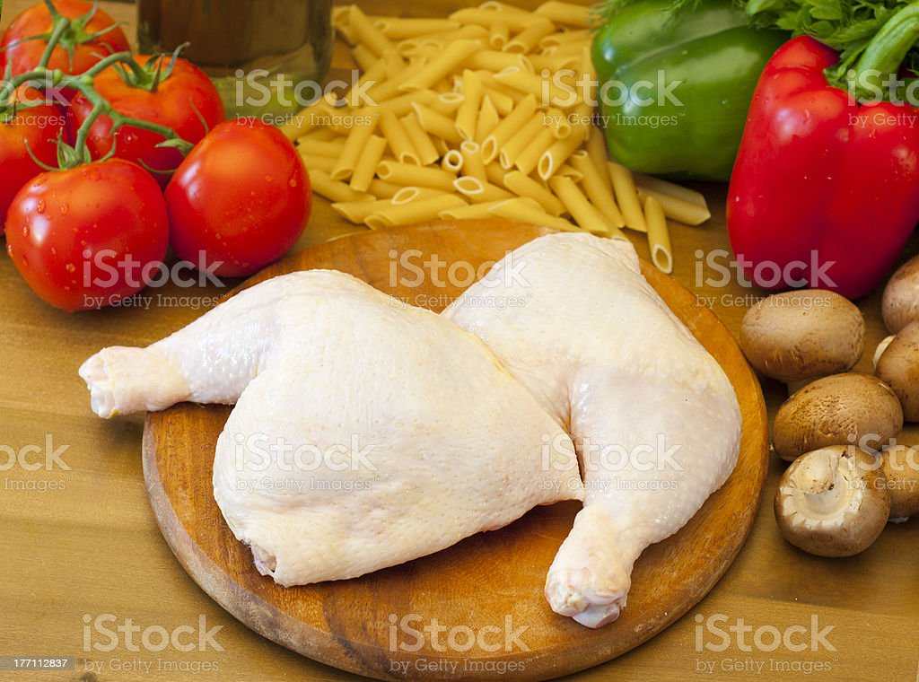 Fresh raw chicken quarters prepared for cooking stock photo