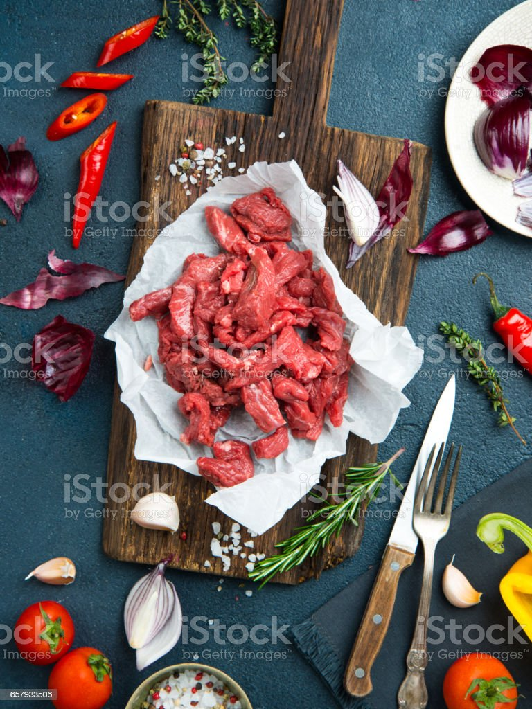 Fresh raw chopped beef on a wooden cutting board stock photo