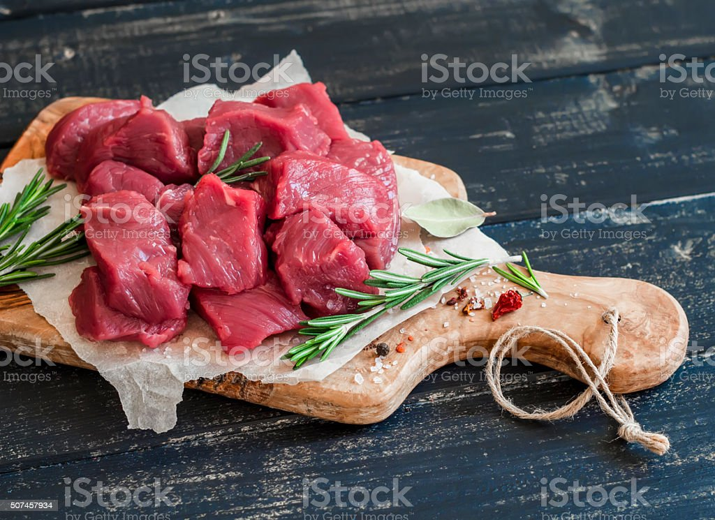 Fresh raw chopped beef, spices and herbs stock photo