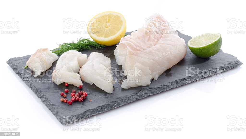 Fresh raw cod fillet on a slate plate stock photo