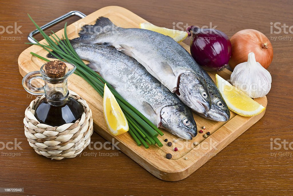 Fresh raw fish trout on wooden board royalty-free stock photo