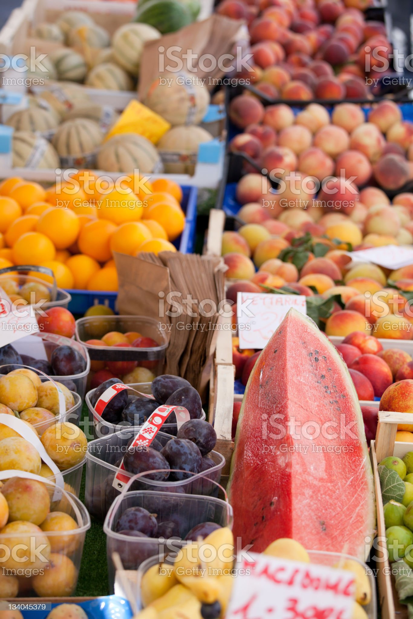 Fresh raw fruits in baskets, boxes at street market close-up royalty-free stock photo