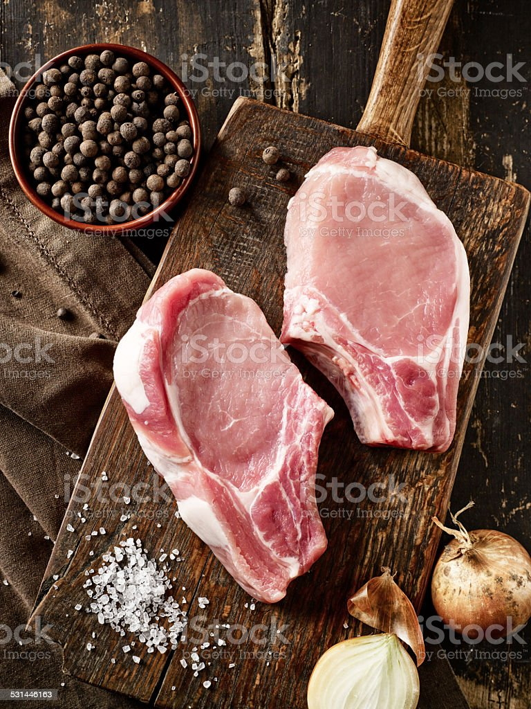 fresh raw meat on wooden cutting board stock photo