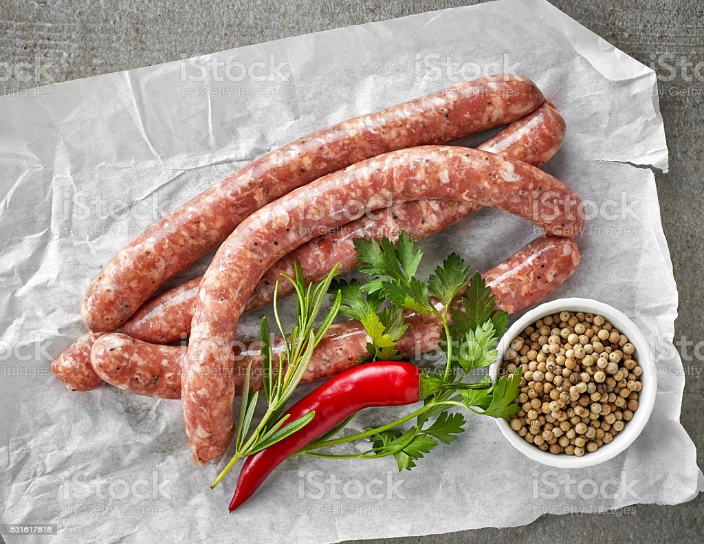 fresh raw meat sausages stock photo