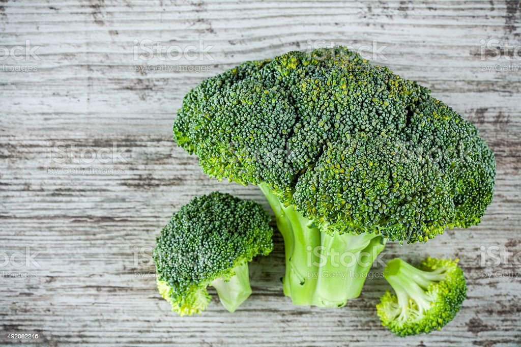 Fresh raw organic broccoli on a wooden background stock photo