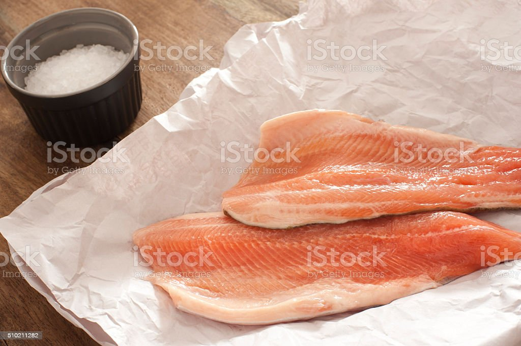 Fresh raw rainbow trout fillets stock photo