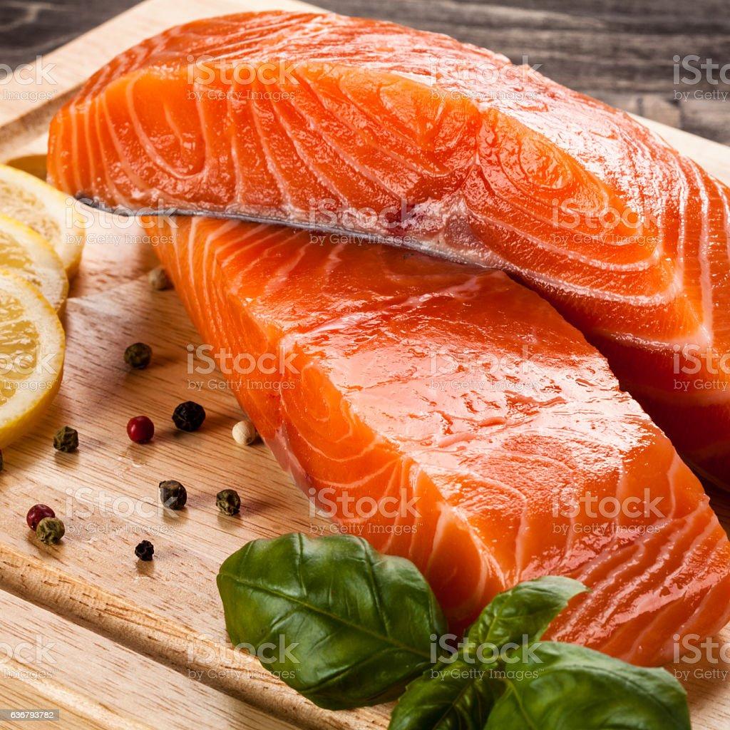 Fresh raw salmon fillet on cutting board stock photo