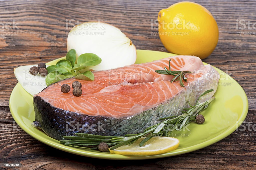 Fresh raw salmon red fish steak with spices royalty-free stock photo