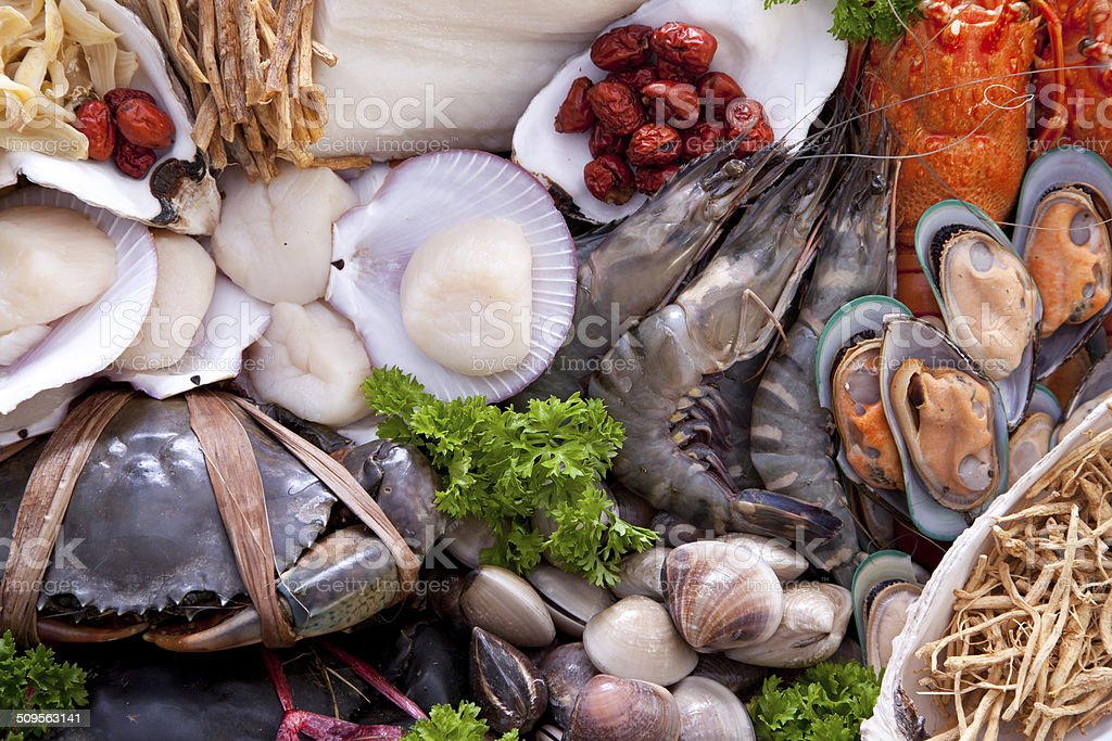 Fresh raw sea food and herbs stock photo