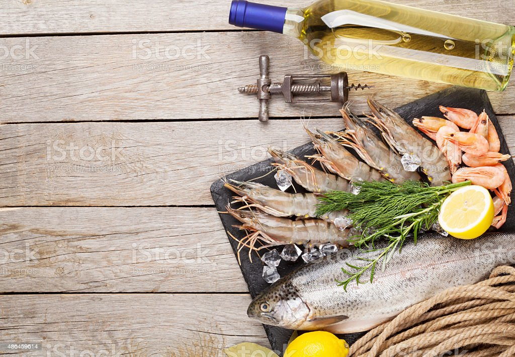 Fresh raw sea food with spices and white wine stock photo