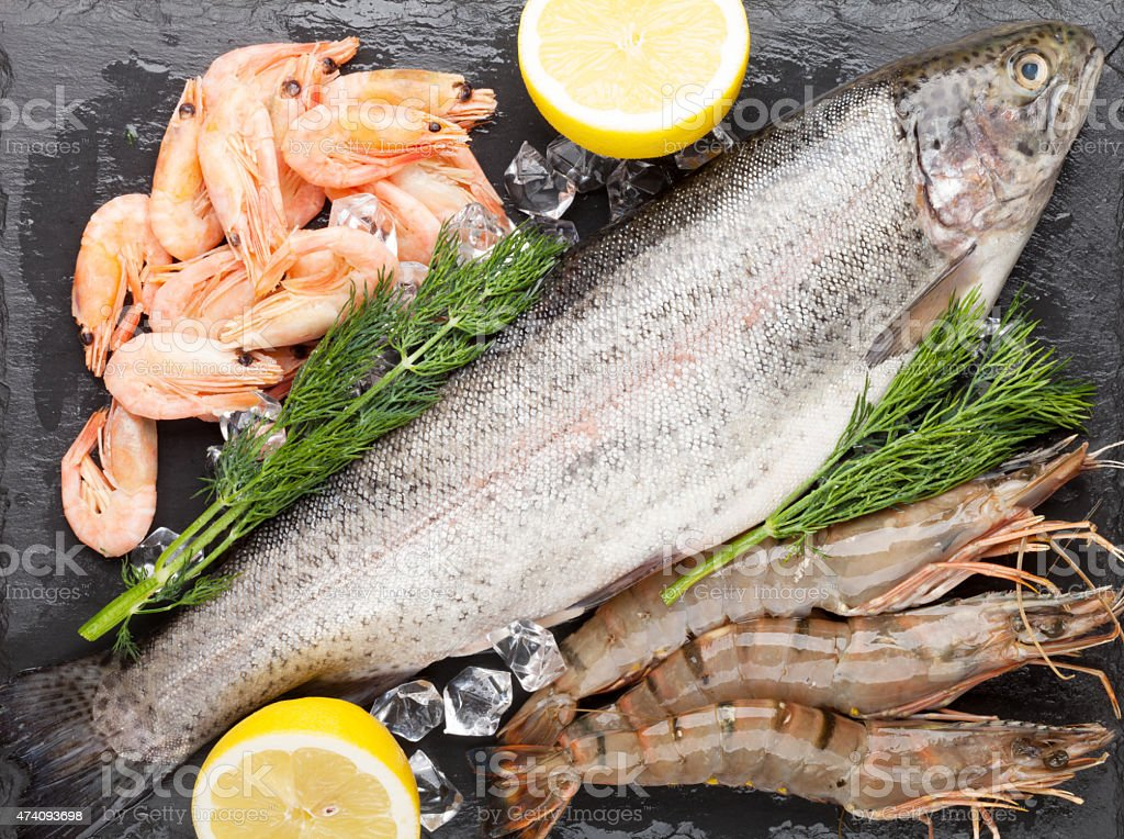 Fresh raw sea food with spices stock photo