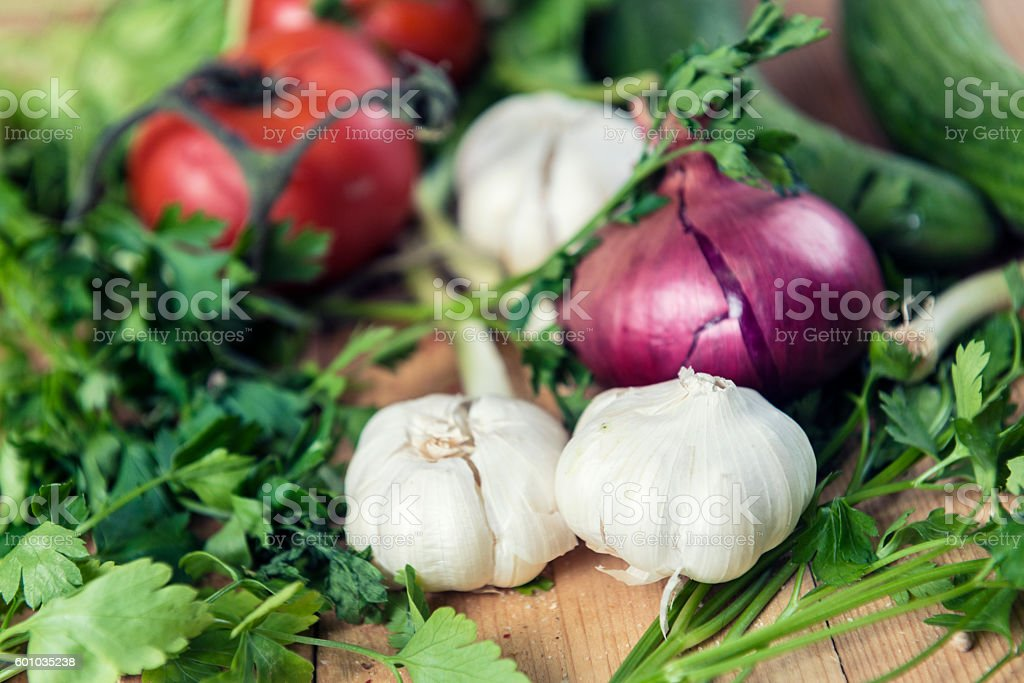 Fresh Raw Vegetable Ingredients On Old Wooden Table stock photo
