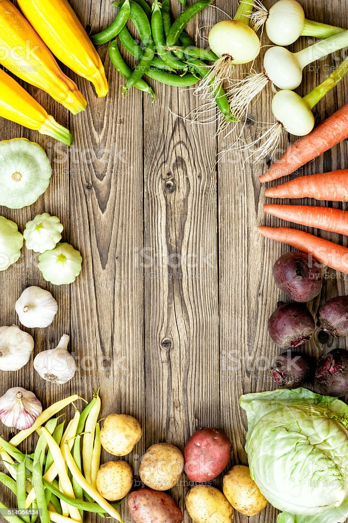 fresh raw vegetables on rustic wooden background stock photo