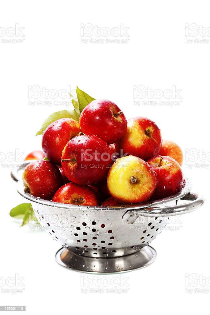 Fresh red apples in metal colander royalty-free stock photo