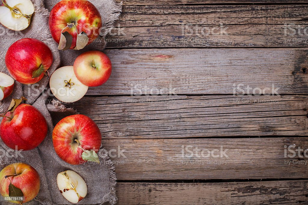 Fresh red apples on wooden background stock photo