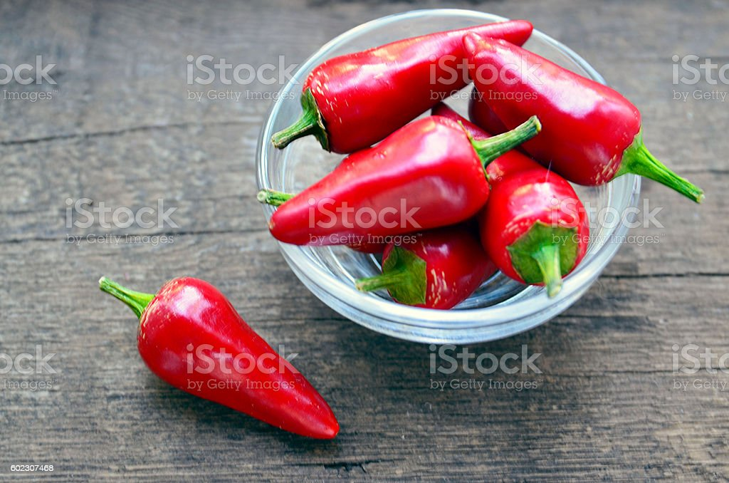 Fresh red chili pepper or chilli cayenne peppers stock photo