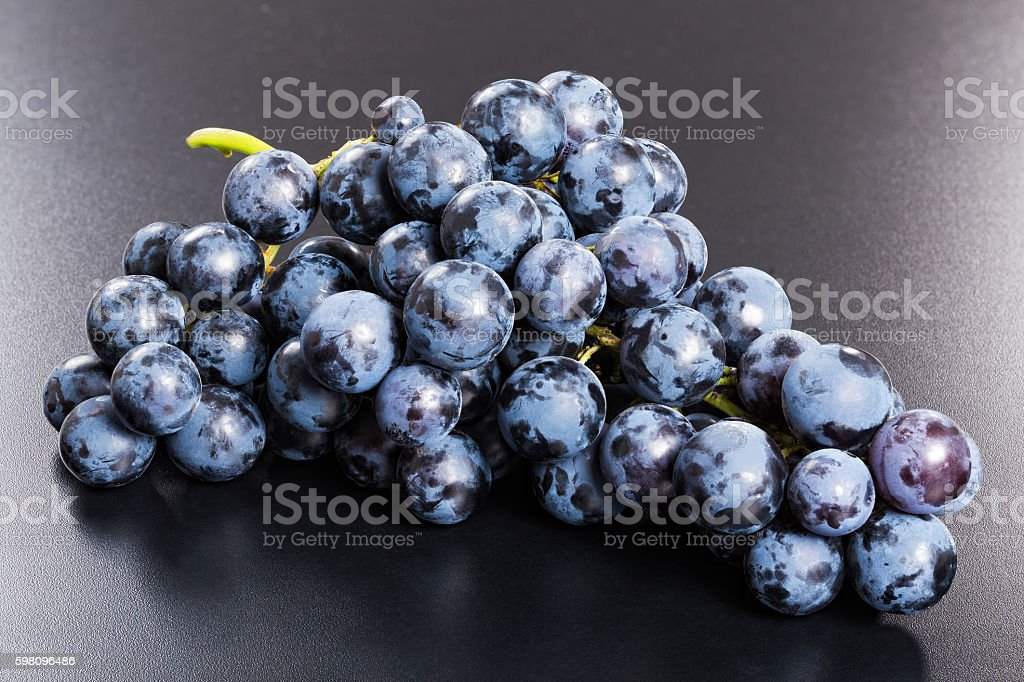 Fresh red grapes bunch on black background stock photo