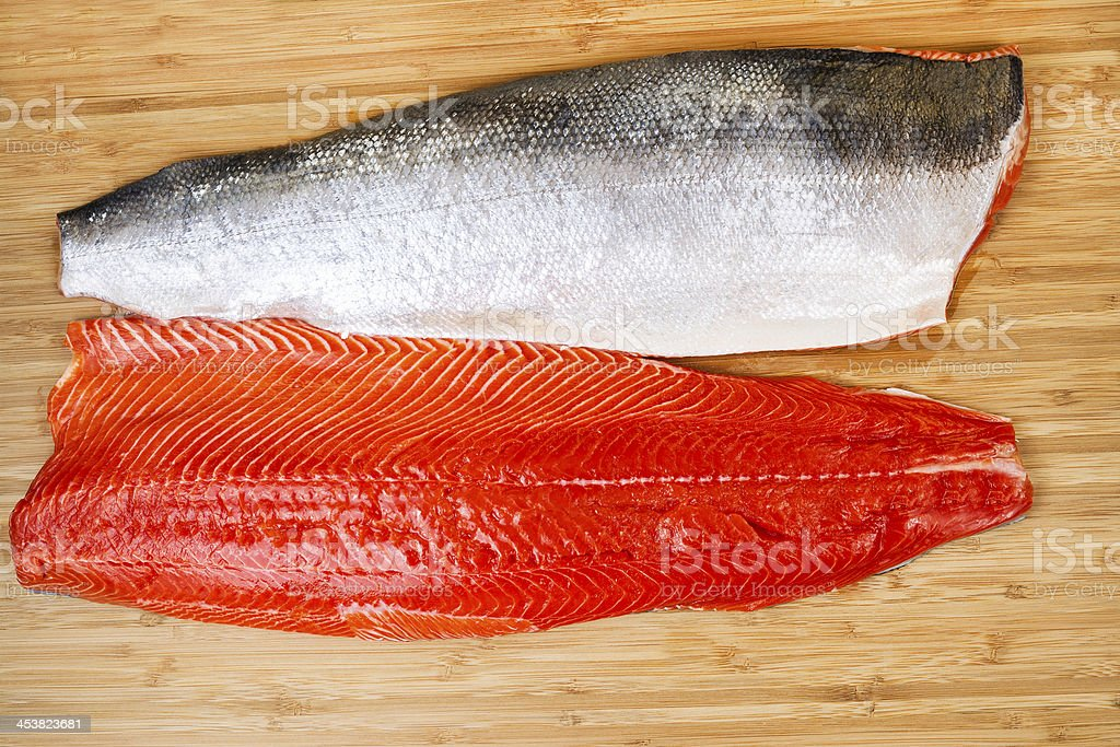 Fresh Red Salmon Fillets on Bambbo Board stock photo