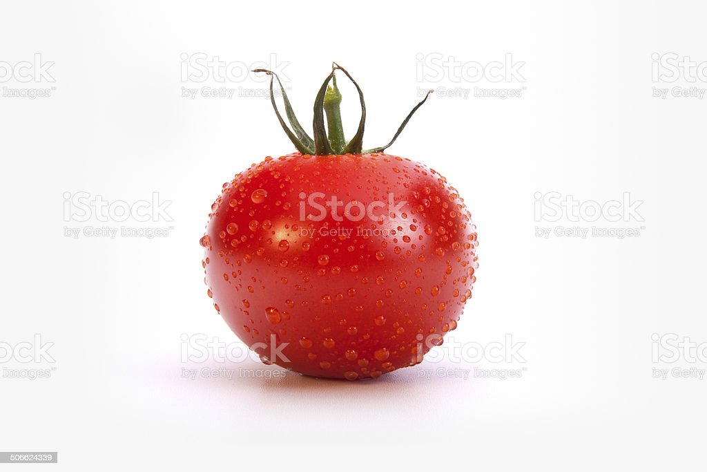 Fresh red tomato, close-up, isolated on white royalty-free stock photo