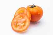 Fresh red tomatoes slice isolated