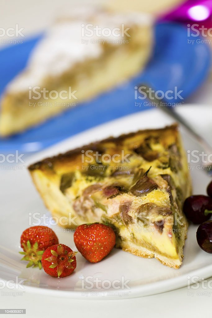 fresh rhubarb cake with strawberry and cherry ,selective focus stock photo