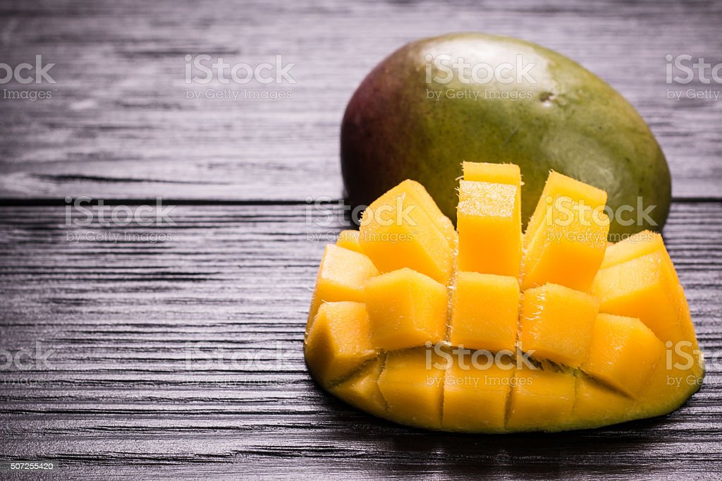 Fresh rip mango on a wooden background.Healthy food stock photo