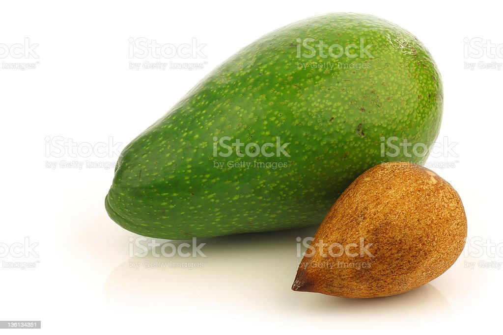 fresh ripe avocado and a seed royalty-free stock photo