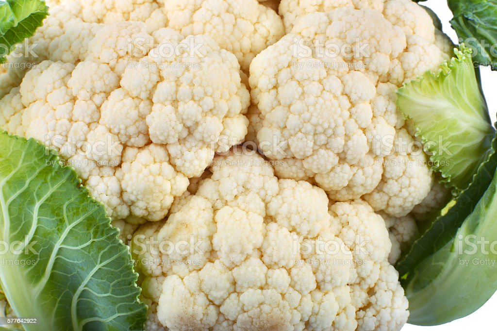 Fresh ripe cauliflower with green leaves isolated on white stock photo
