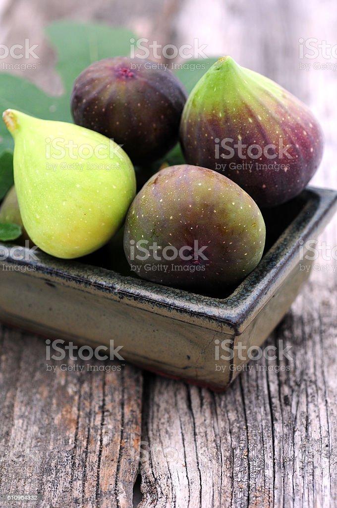 Fresh ripe figs in bowl stock photo