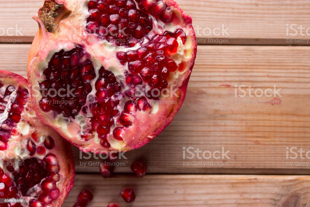 Fresh ripe garnet on table stock photo