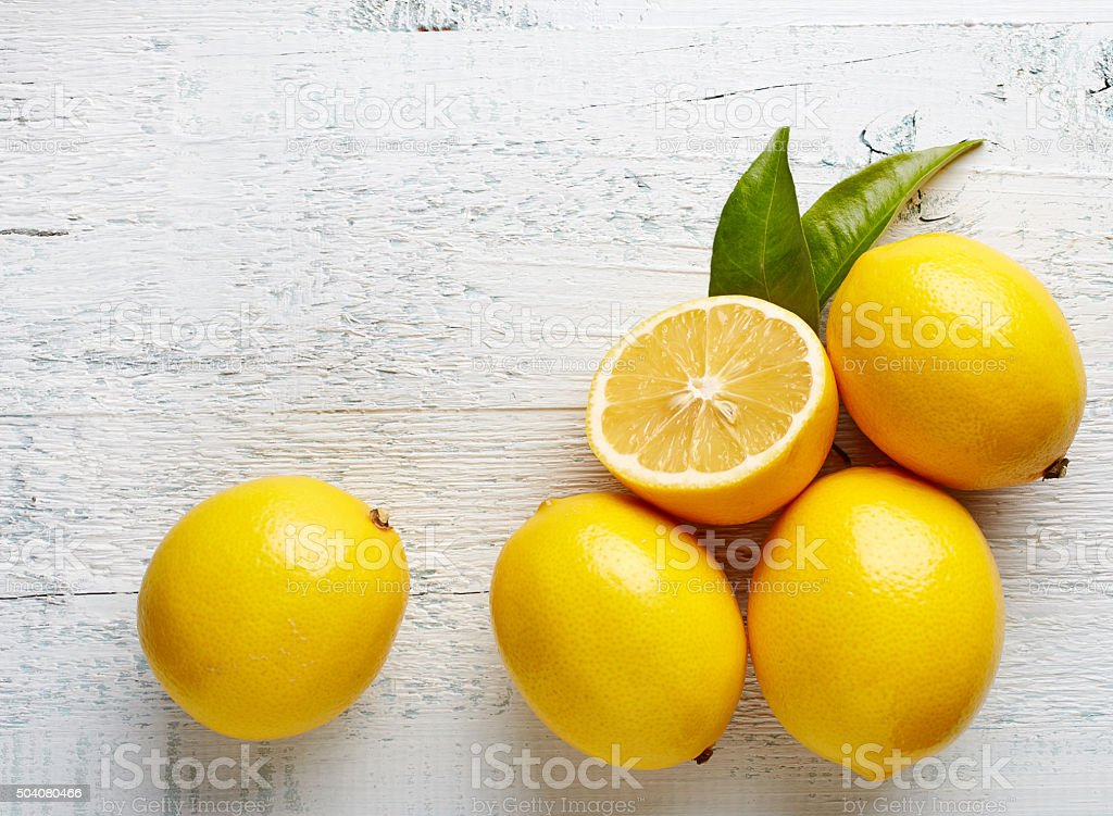 fresh ripe lemons on wooden table stock photo