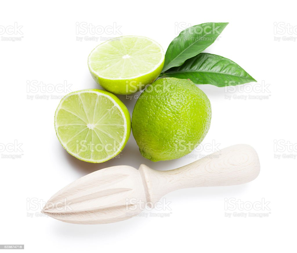 Fresh ripe limes and juicer stock photo