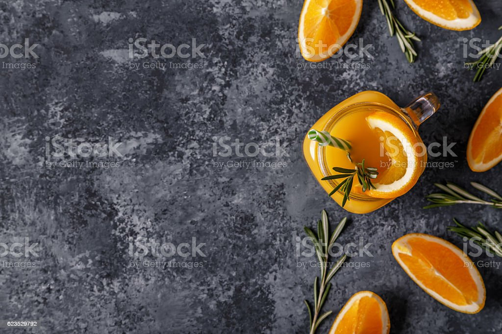 Fresh ripe oranges and juice on stone table. stock photo