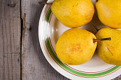 Fresh ripe organic yello pears on rustic wooden table, natural