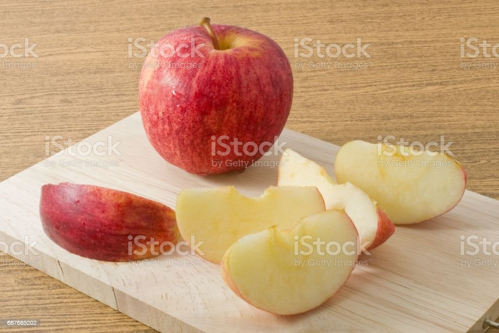 Fresh Ripe Red Apple on Wooden Cutting Board stock photo