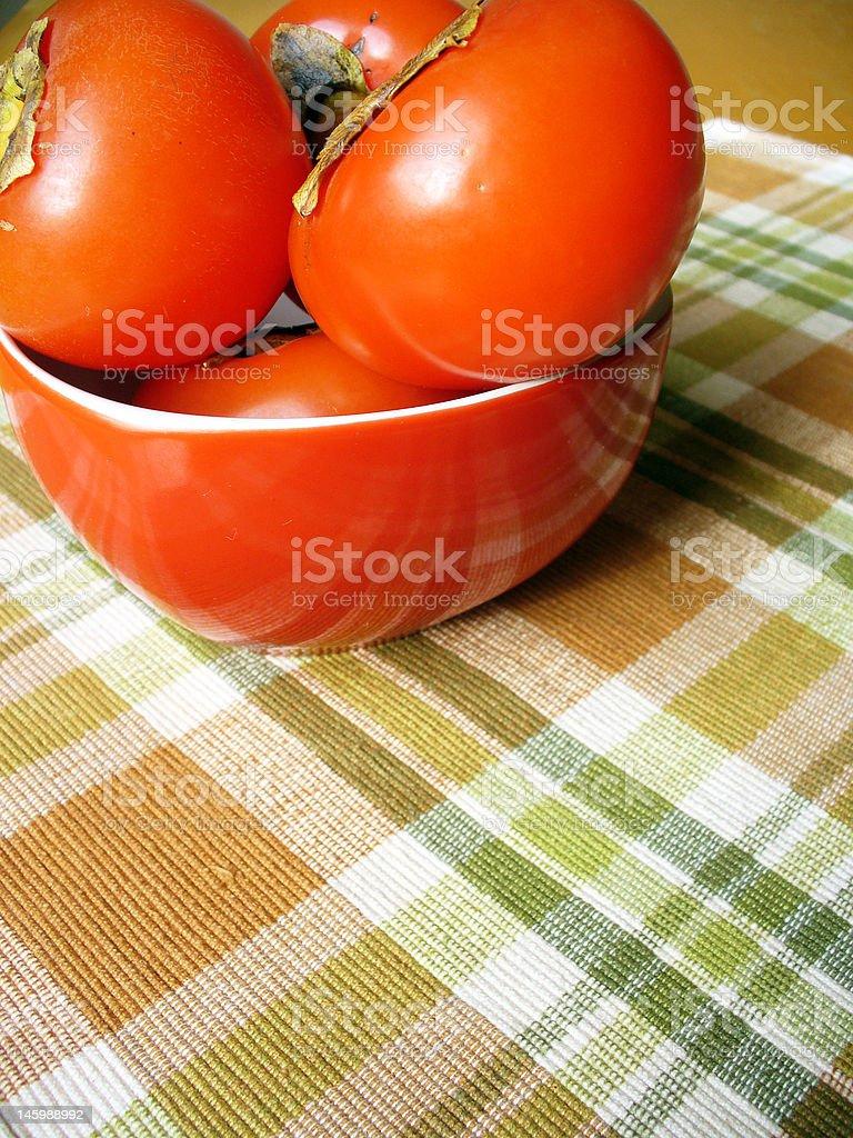 Fresh ripes persimmons royalty-free stock photo