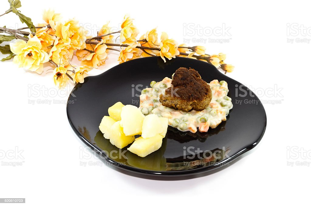 Fresh Rissole with Creamed vegetables and Salt Potatoes stock photo