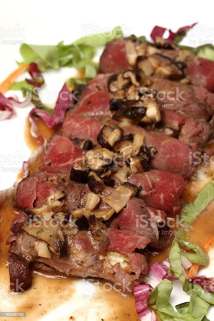 Fresh roast beef with mushroom sauce stock photo