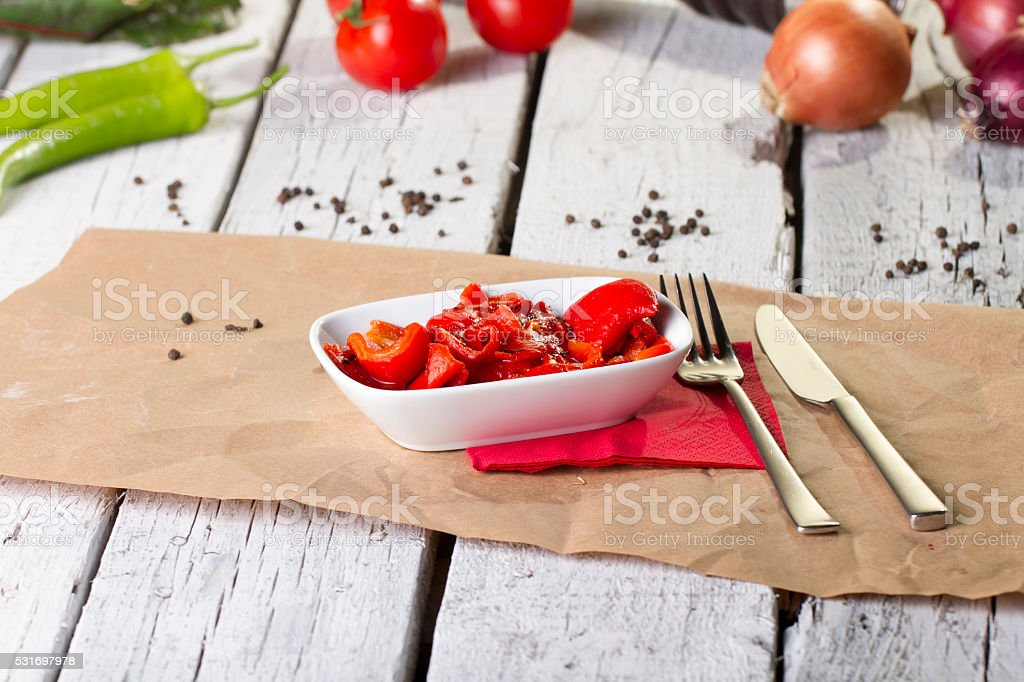 Fresh roasted red pepper with garlic and olive oil stock photo