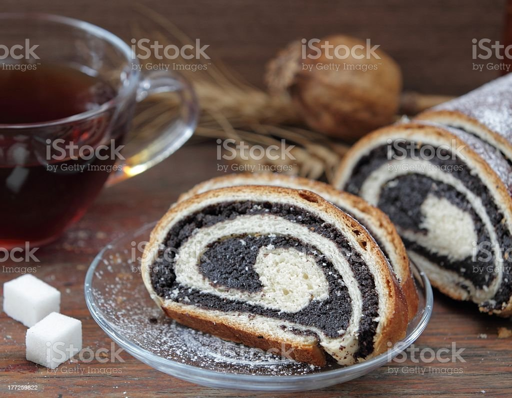 Fresh roll with poppy and tea royalty-free stock photo