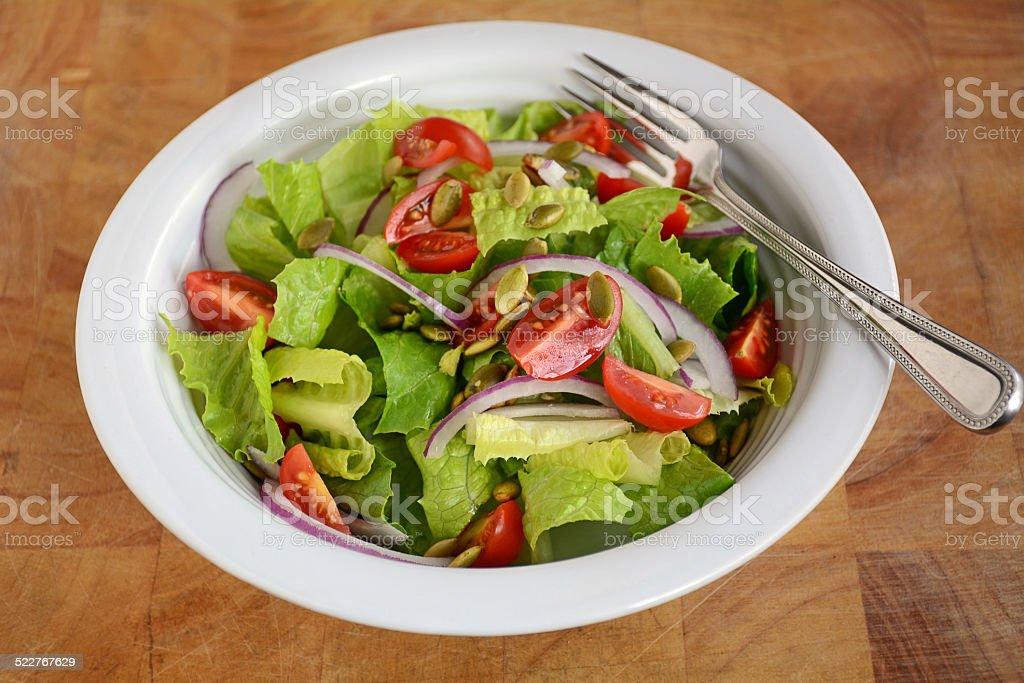 Fresh romaine and cherry tomato salad stock photo