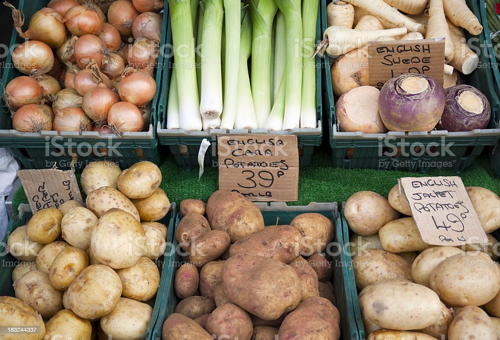 Fresh root vegetables for sale outside a shop stock photo