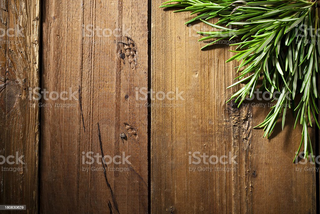 Fresh rosemary on rustic wooden table royalty-free stock photo